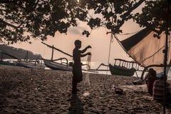 Fishermen preparing nets. Stock Image