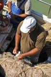 Fishermen preparing nets in the port, Chipiona, Cadiz, Spain Stock Image