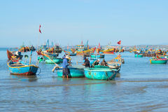 Fishermen are preparing to go to sea to fish in the Fishing harbour of Mui Ne. Vietnam Royalty Free Stock Photography
