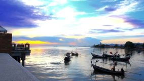 Fishermen preparing to sail and People swim in the. Kayak next to fishing boats at beautiful sunset. Video speed up 1920*1080 stock footage