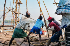 Fishermen pull out their Chinese fishing net from sea Stock Image