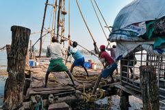Fishermen pull out their Chinese fishing net from sea Royalty Free Stock Photo