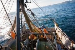 Fishermen pull trawl fish Stock Images