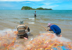 Fishermen pull up the fishing net in sea Royalty Free Stock Photo
