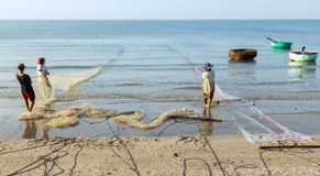 Fishermen is pulled fishes in the fishing net Stock Photos