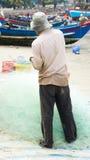 Fishermen pulling a fishing net Stock Photography