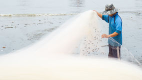 Fishermen pulling a fishing net Stock Photos