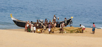 Fishermen are pulling their fishing net in combine Stock Images