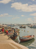 Fishermen at Punta del Este Port Stock Images