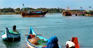 Fishermen are ready to catch fish in the river arasalaru near karaikal beach. Fishermen are ready to catch fish in the river arasalaru near the karaikal beach royalty free stock photos