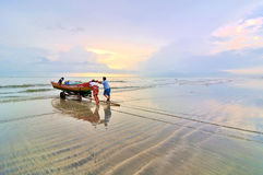 Fishermen ready to go to the sea at the morning. Royalty Free Stock Photo