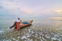 Fishermen ready to go to the sea at the morning. Royalty Free Stock Image