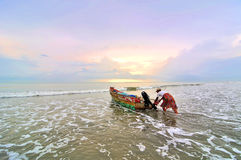 Fishermen ready to go to the sea at the morning. Stock Photography