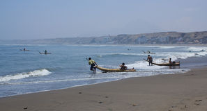 Fishermen on reed boats, Huanchaco,Peru. Fishermen of Huanchaco fish with traditional methods. These boats  are  a tourist attraction and are known locally as Stock Images