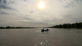Fishermen releasing fishing net in Danube delta. Two fishermen`s dropping fishing net in Danube Delta Romania stock footage
