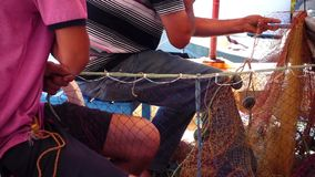 Fishermen Repair Fishnet Fishing Lines stock footage