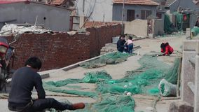 Fishermen repair nets. stock video footage