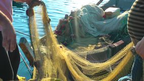 Fishermen Repairs Fishnets stock footage