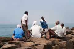 Fishermen are resting after work on Samudra beach in Kovalam Stock Image