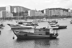 Fishermen in Rio 2. Look of a fishing boats marina in Rio de Janeiro, Brasil with modern buildings in the back Royalty Free Stock Photos