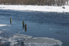 Fishermen on river. Stock Photo