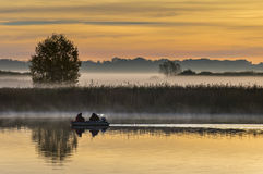 Fishermen on a river at dawn. The image was taken on the Lielupe river in Jurmala, Latvia Stock Photos