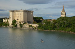 Fishermen on river Rhone under castle Tarascon Royalty Free Stock Images