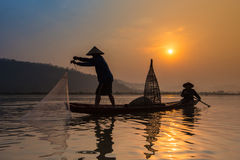Fishermen on river at sunrise Royalty Free Stock Photo