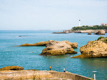 Fishermen, rock formations, lighthouse and port of Biarritz, Bas Royalty Free Stock Photography