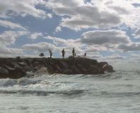 Fishermen on rock pier Royalty Free Stock Images