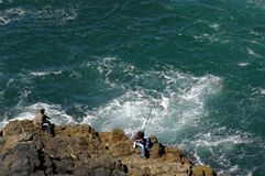 Fishermen in the rocks Royalty Free Stock Photography