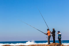 Fishermen Rods Rocks Blue Sea Stock Photos