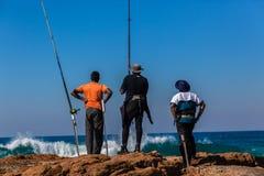 Fishermen Rods Rocks Blue Sea Stock Images
