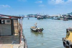 Fishermen rolling a small boat. At Yangjiang Harbor of China royalty free stock photos