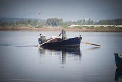 Fishermen in rowboat Stock Images