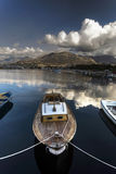 Fishermen`s boat. Nice dynamic range Landscape image of a small boat with mountains at the background Royalty Free Stock Image