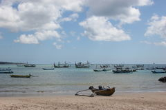 Fishermen`s boats in Bali. Fishermen`s boats on the beach in front of the fish market in Jimbaran, Bali Stock Images