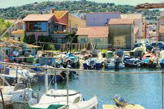Fishermen`s district of Sete, France. SETE, FRANCE - July 15, 2016: fishermen`s boats and huts in the Fishermen's district village of Sete called La stock photo
