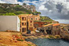 Fishermen`s houses in Cala s`Almonia, on the coast of Migjorn, S. Antanyi, Mallorca, Balearic Islands, Spain Royalty Free Stock Photos