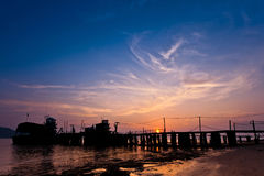 Fishermen's Jetty. A fishermen's jetty in Tanjung Dawai, Kedah, Malaysia at sunset with a deep sea fishing boat Royalty Free Stock Photos