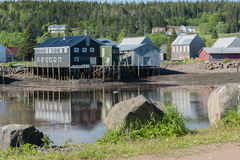 Fishermen`s sheds in the cove. Fishermen`s work sheds safely nestled in the harbor Stock Photography