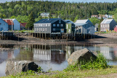 Fishermen`s sheds in the cove. Fishermen`s work sheds safely nestled in the harbor Royalty Free Stock Image
