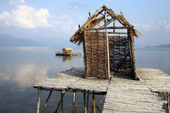 Fishermen`s village. With houses made of cane and wooden docks in southern Europe Stock Photography