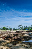 Fishermen's Village from Dungun Beach. View of rocky beach and fishermen's village at Dungun, Terengganu Stock Images