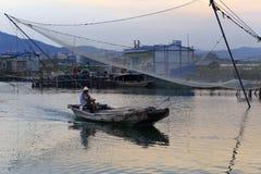 Fishermen sail. Under the big fishing nets in maluan bay fishing ground, amoy city, china Royalty Free Stock Photo