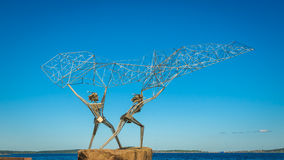 Fishermen sculpture, Onega lake embankment, Petrozavodsk, Russia. Fishermen sculpture on Onega lake embankment, Petrozavodsk, Russia Stock Image