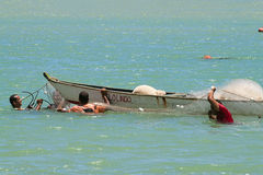 Fishermen in the sea Royalty Free Stock Image