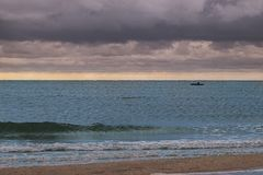 Fishermen and Sea. Despite the bad weather, the fishermen went out to sea for fishing Royalty Free Stock Photo