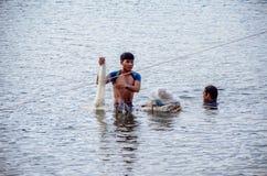 Fishermen. At Sea Lake, Gia Lai, Viet Nam royalty free stock images