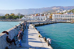Fishermen on the seafront of Yalta Stock Images